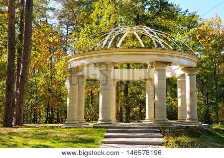 beautiful gazebo in autumn park and sky