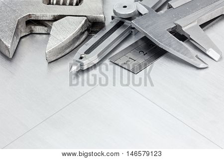 Tool Set Of Calipers, Wrenches And Ruler On Scratched Metal Background For House Renovation