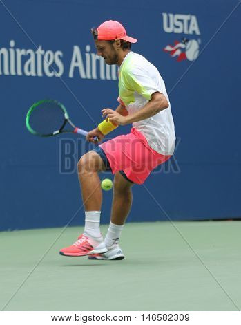 NEW YORK - SEPTEMBER 6, 2016: Professional tennis player Lukas Poulle of France using Tweener during round four match at US Open 2016 at Billie Jean King National Tennis Center