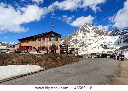 Alpine hut Rifugio Bonetta at gavia pass and mountain Corno dei Tre Signori Italy