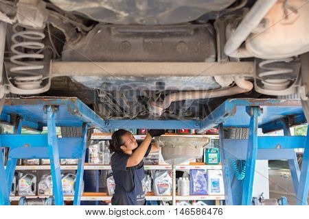 Checking A Car At Garage