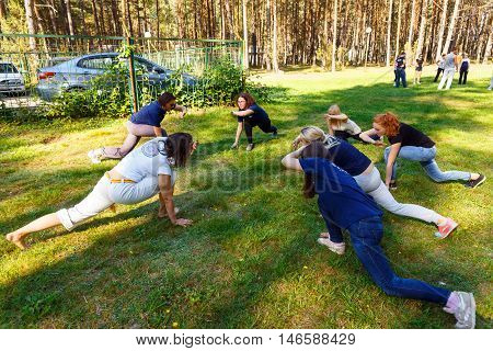 GRODNO BELARUS - SEP 09: Group of capoeira students with master teacher in FICAG school in Grodno Belarus at September 09 2016