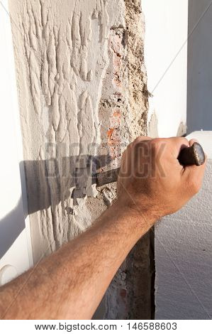 Breaking Plaster During The Reconstruction Of The House.