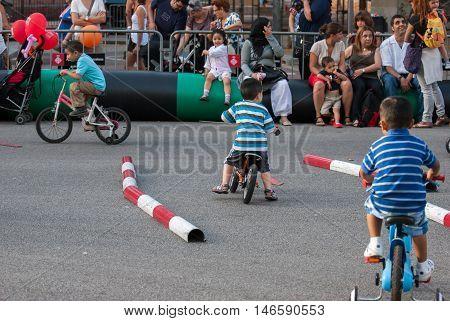 JUNE 18 2011 - BARCELONA SPAIN: Little kids study the rules of the road traffic at street Barcelona's festival