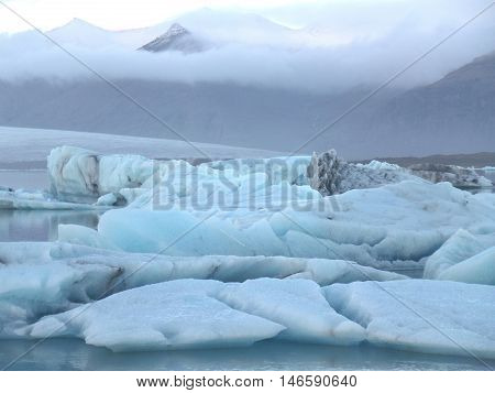 The Stunning View of Blue Icebergs floating in Jokulsarlon Glacier Lagoon, South Iceland