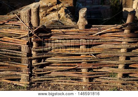 Wooden protection in the form of a rural wattle fence