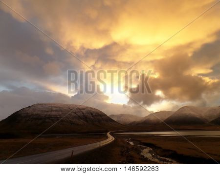 Stunning Golden Sunset Sky View on the way to Mount Kirkjufell, Iceland