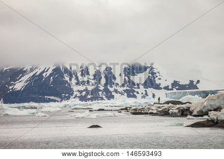 Mountains covered with snow and fog in Antarctica. landscape for background.