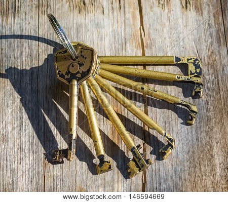 professional set of master keys for locks on an old wooden surface