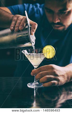 Barman making classic margarita cocktail close up