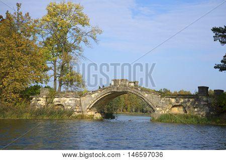 Humpback bridge (Bridge between Islands), september day. Gatchina, Russia