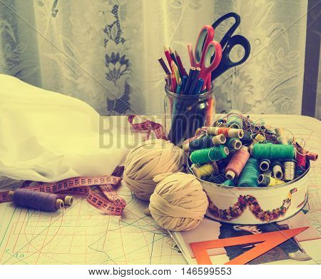 Sewing supplies and accessories on the table tool craft old photo retro style