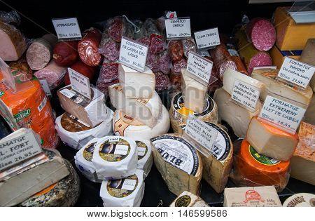 JUNE 14 2011 - BARCELONA SPAIN: Lot of cheese at La Boqueria market in Barcelona. Spain