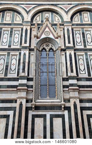 Gothic window - a detail of the facade of the Duomo cathedral in Florence, Italy