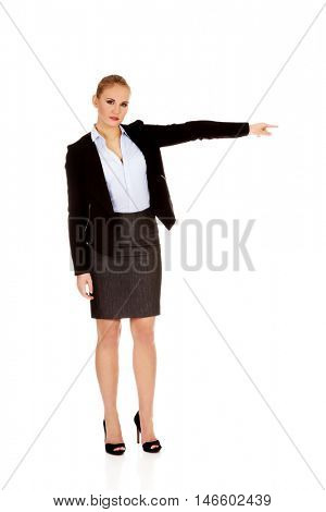 Angry business woman shows get out gesture