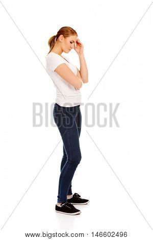 Worried young woman touching her head