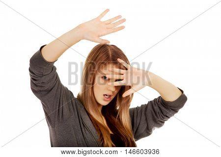 Teenage woman try to hiding herself