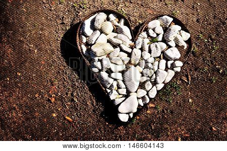 Close up of a metal Heart filled with white stones