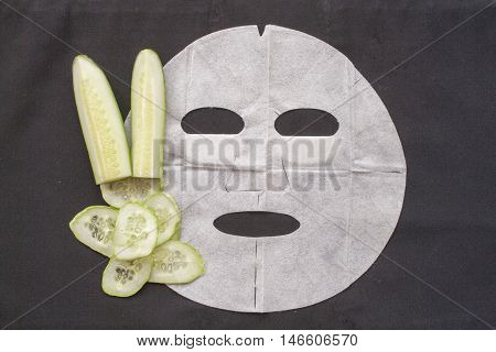 natural sheet mask extracts from cucumber for face skin care brightening on background black