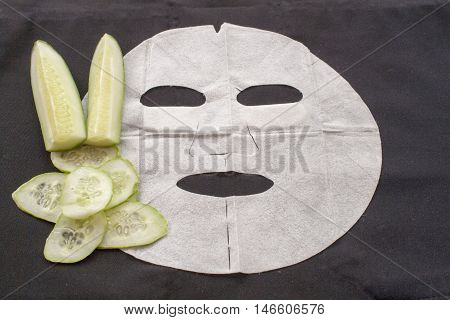 natural sheet mask for the face herbal is cucumber brightening pure skin care on background  black