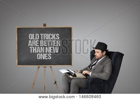Old tricks are better than new ones text on  blackboard with businessman and key