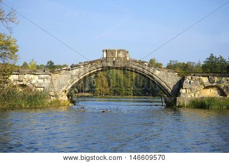 The old Humpback bridge (Bridge between Islands), september day. Gatchina, Russia