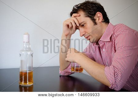 Man feeling bad because of alcohol abuse