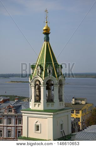 The belfry of the old Church of St. John the Baptist on the background of the Volga river close up. Nizhny Novgorod