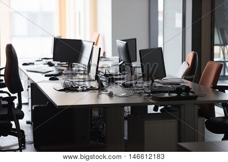 empty startup office interior with modern computers and  dual screen monitors