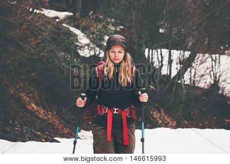 Traveler Woman with backpack hiking Travel Lifestyle concept active vacations outdoor autumn forest on background rainy moody weather