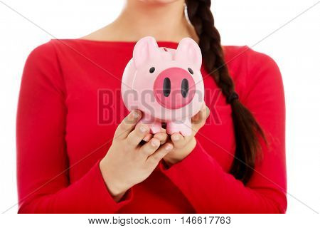 Young casual woman holding a piggybank