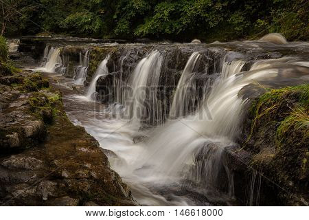 The gully leading to Panwar, or Sgwd y Pannwr waterfall on the Mellte river, near Pontneddfechan in South Wales, UK.