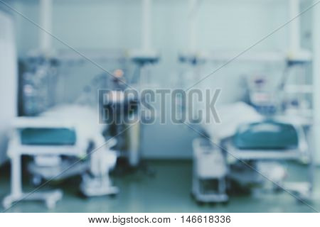 Two beds in intensive care unit blurred background.