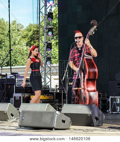 St. Petersburg, Russia - 12 August, Duet of musicians with bass,12 August, 2016. Pop and rock musicians on Harley Davidson festival in St. Petersburg.