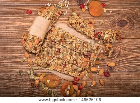 Homemade energy bars on the wooden table.