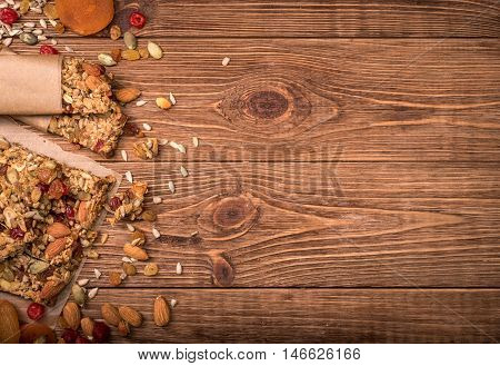 Homemade energy bars on the wooden table . Background.