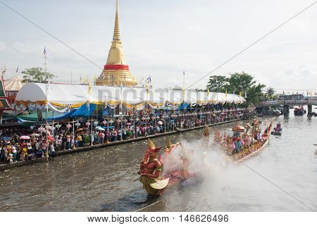 SAMUT PRAKAN,THAILAND-OCTOBER 26, 2015 :The Lotus throwing into the boat (Rup Bua Festival ) in Samut Prakan,Thailand. Devotees throw lotus flowers to boat procession that carry Buddha image on the end of Buddhist Lent.