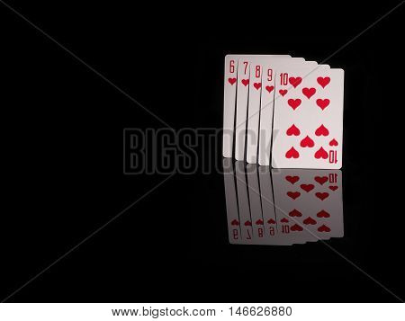 Straight Flush playing cards isolated on black background. casino concept
