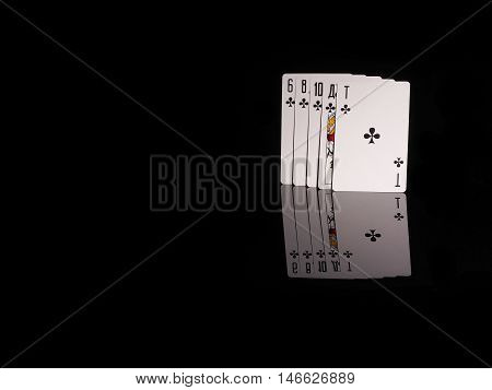 flush playing cards isolated on black background. casino concept
