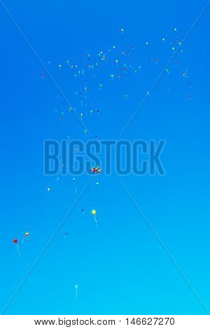 a lot of colorful balloons in blue sky