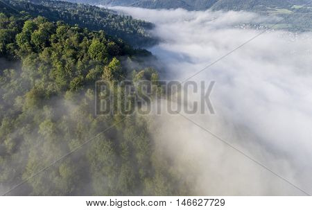 Landscape Misty Panorama. Fantastic Dreamy Sunrise On Rocky Mountains With View Into Misty Valley Be