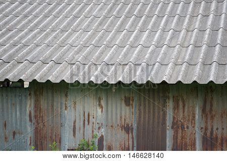 close up old tile roof and zinc wall in country Thailand