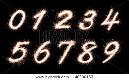 Number 0123456789 made of sparklers font isolated on black background