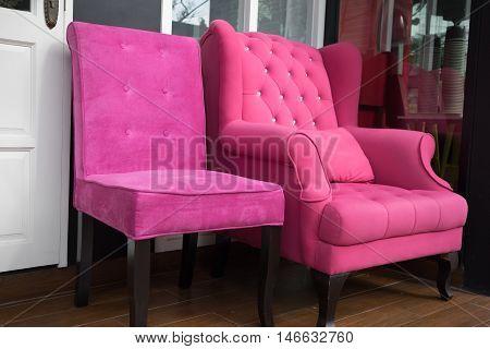 Pink Fabric Armchair Beside White Door