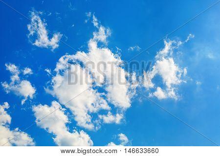 Clouds in blue sky. Blue sky with white fluffy cumuli clouds.