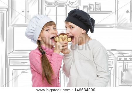 Beautiful boy and girl in chef hats biting monkey shape christmas cookie. Children standing over kitchen drawing background.