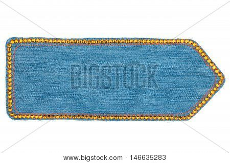 Arrow made of denim with yellow rhinestones isolated on a white background