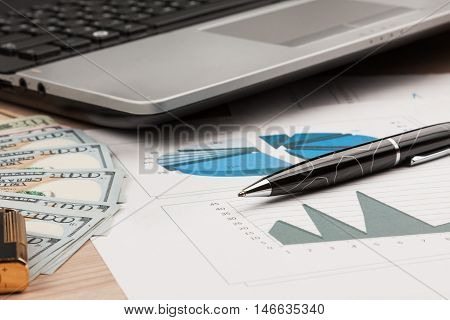 Working businessman desk Lighter and laptop and money as the background