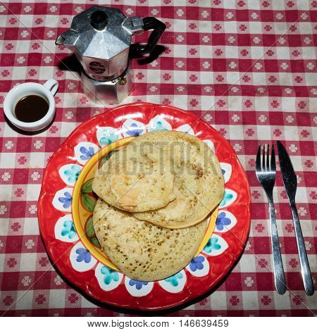 Italian brakfast with homemade pancakes neapolitan coffee and maple syrup