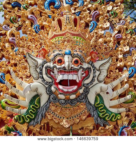 Traditional Barong mask pattern in temple - protective spirit Bali island symbol. Featured in Balinese dances and ceremonies. Culture religion Arts festivals of Indonesian people. Travel background